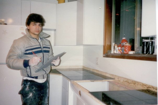 A young Tom Munro pictured holding a piece of granite as he works on his first granite countertop